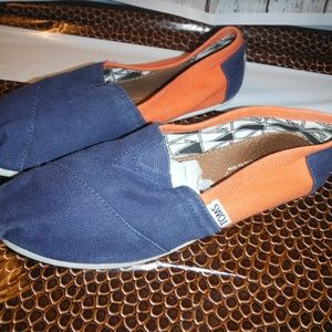 orange and blue Toms canvas shoes UVA colors